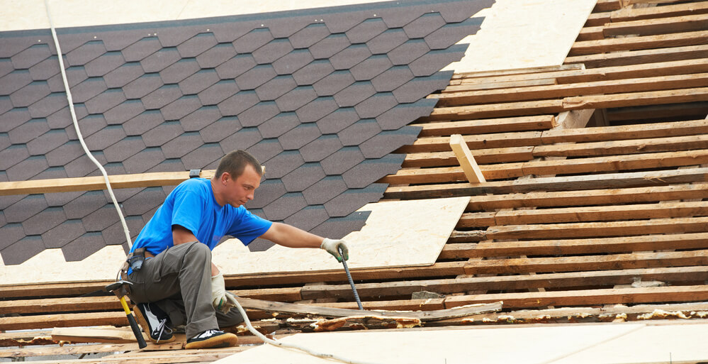 Insurance Claimant Shingling a Roof